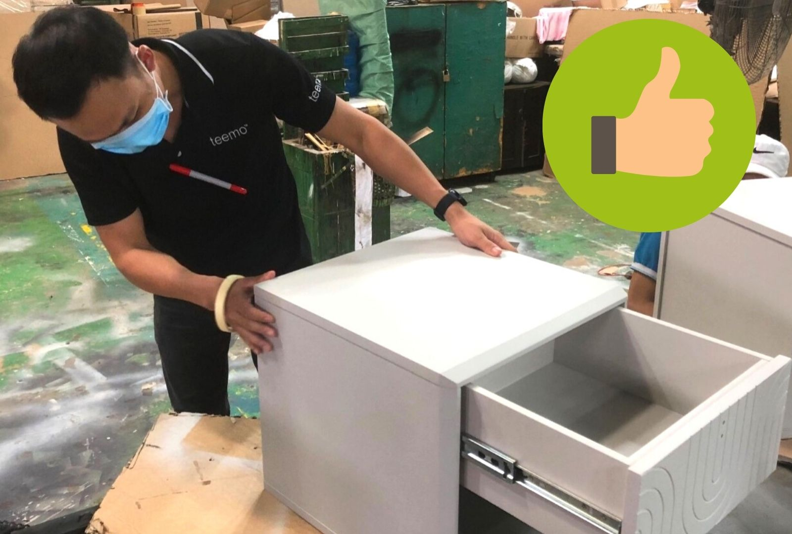 Our QC professional Richard checking the quality of a set of drawers.